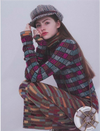 Em Marie in Chanel sweater and hat
