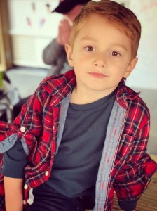5-year-old model in tee and red flannel