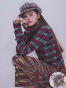 Em Marie in striped sweater and hat