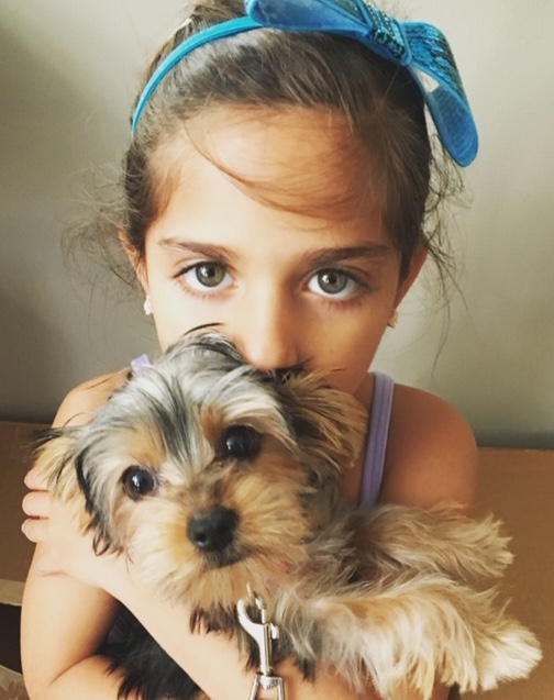 child model with gorgeous eyes holding puppy