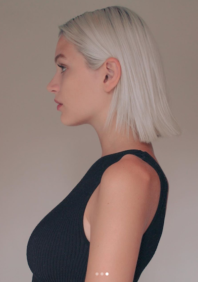 profile of platinum haired model in black tank top