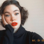 Beautiful model with bright red lips and brown bob