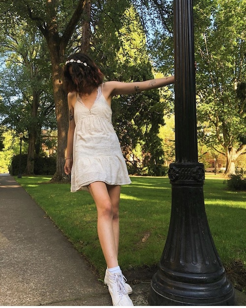 Leggy model in sundress in park