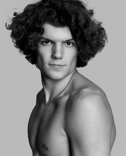 Male model with angular face and wavy, cool hair